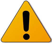 Exclamation in triangle signifies caution